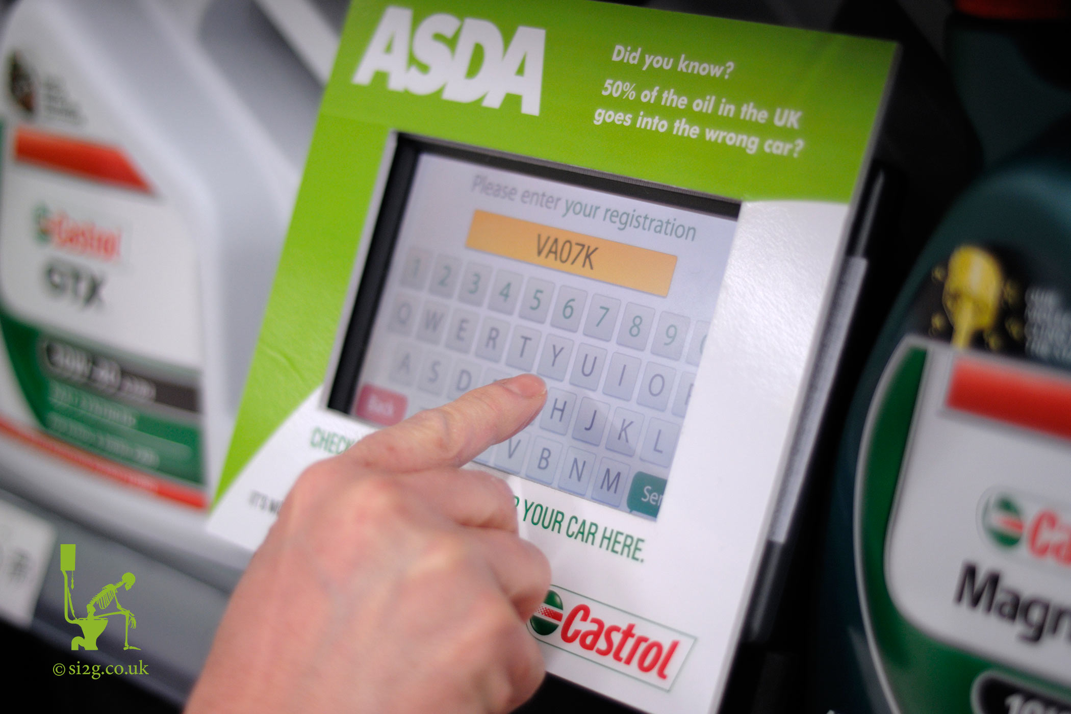 Electronic Oil Database - This device was on trial in a large supermarket.  It tells you what oil your car takes after you enter its number plate.  The company required photographs of the unit in situ for marketing purposes.